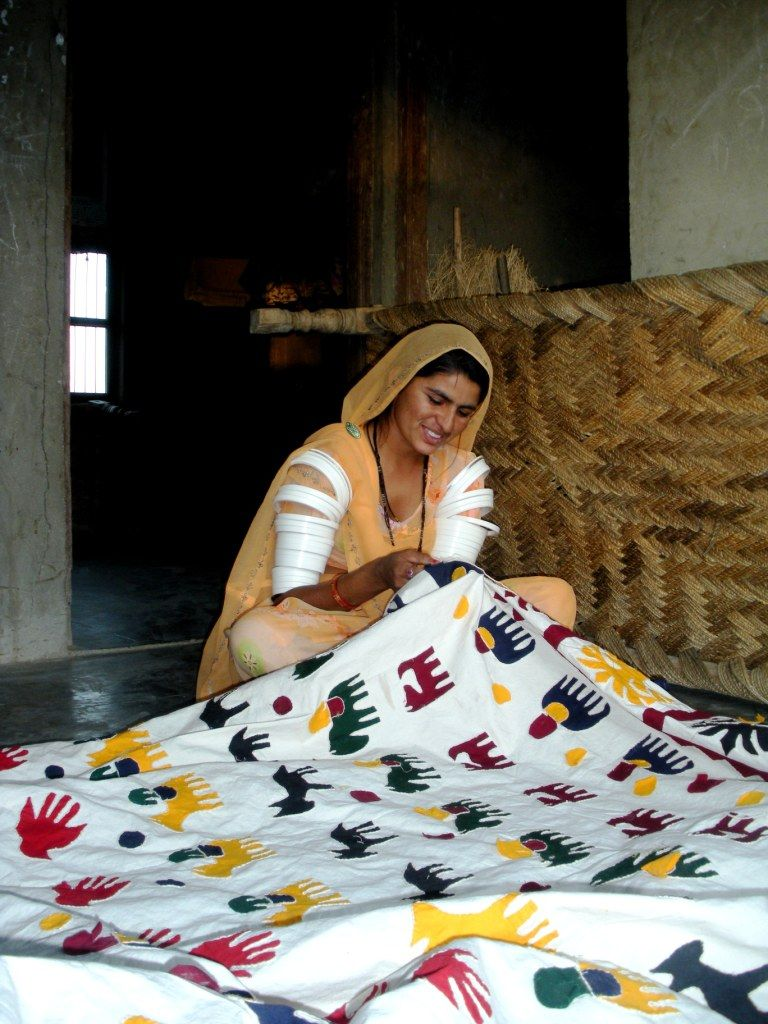 Rural artisan is traditional embroidering patchwork. Badmer ...